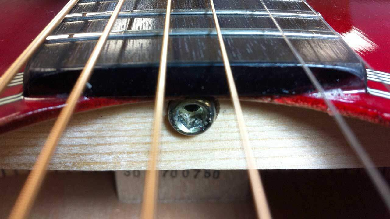 Acoustic truss rod adjuster