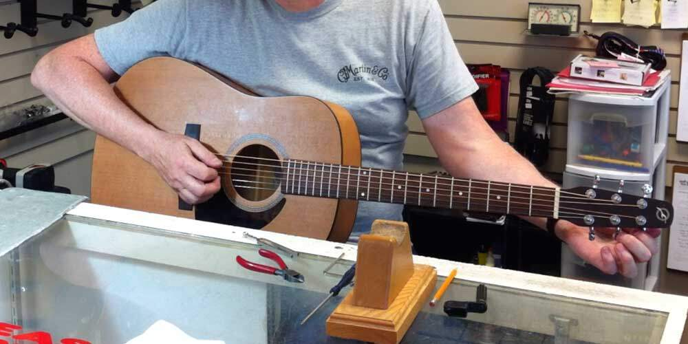 tuning an acoustic guitar, tools for changing guitar strings